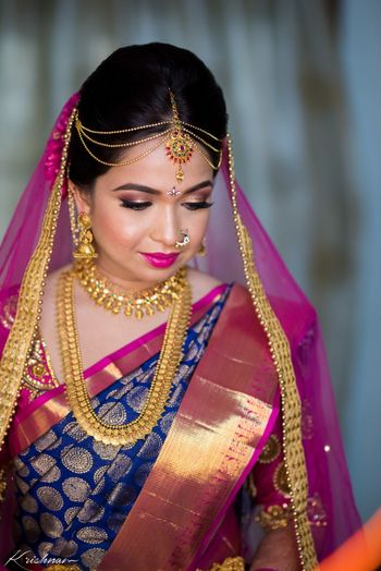 Photo of South Indian bride in contrasting combination kanjiavaram and dupatta
