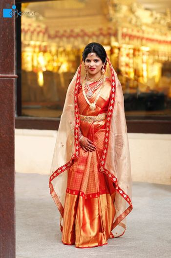Photo of South Indian bridal look with red and gold kanjivaram and dupatta
