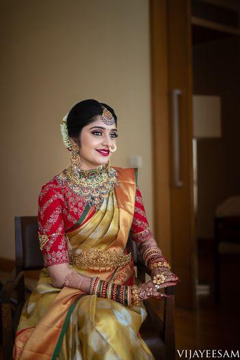 Red and gold bridal kanjivaram and nath