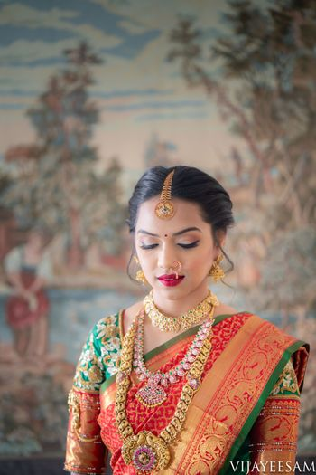 South indian bridal look with layered temple necklaces