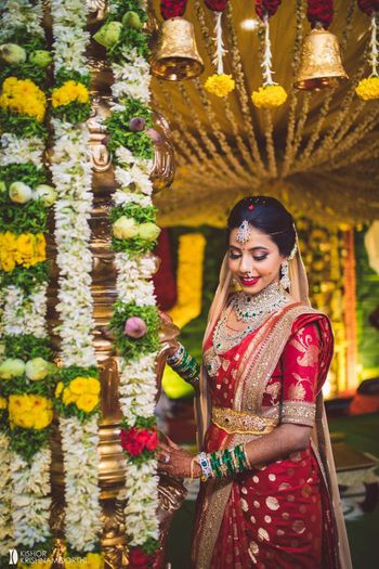 south indian bridal look in a red kanjivaram and waistbelt