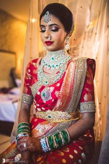 south indian bridal look with layered diamond jewellery and waistbelt