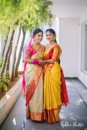 Bride and bridesmaid in pretty sarees
