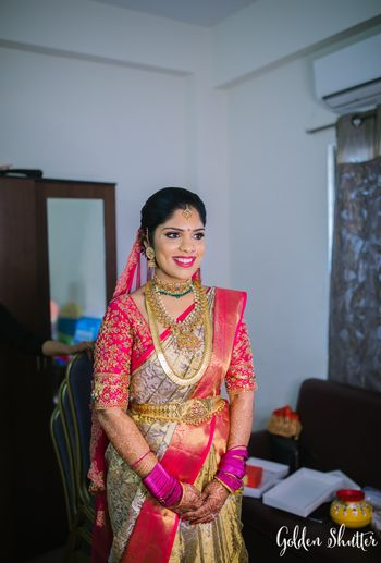 South Indian bride in a Pink & White Kanjeevaram
