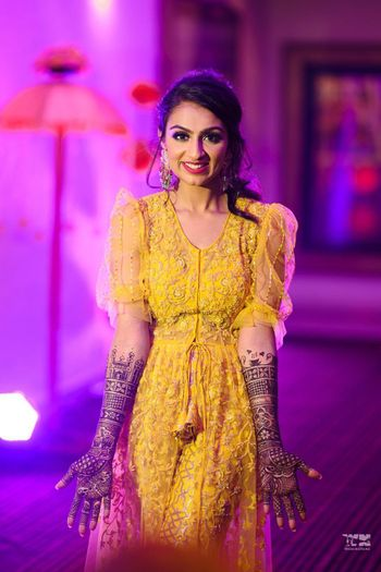 bridal portrait in yellow outfit on her mehendi