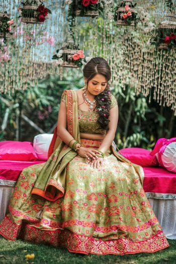 bride in green floral print mehendi lehenga