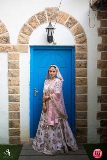 Light bridal lehenga in white and light pink with floral print