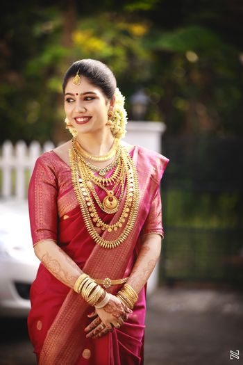 South indian pink saree with traditional south indian gold jewellery