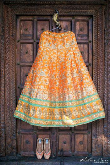 Orange and green benarasi lehenga