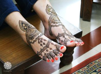 Jewellery style mehendi on feet