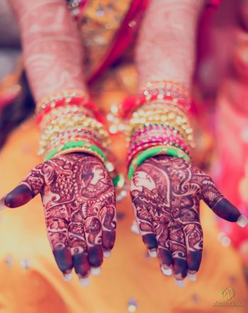 Half and half bridal mehendi with jaimala portrait