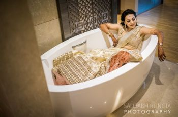 Photo of Bride chilling in bathtub before engagement