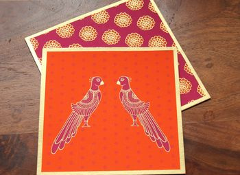 Photo of orange and maroon invitations