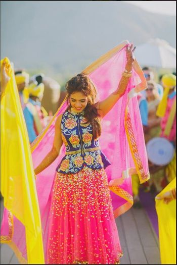 Pretty shimmer lehenga in pink with a peplum blouse