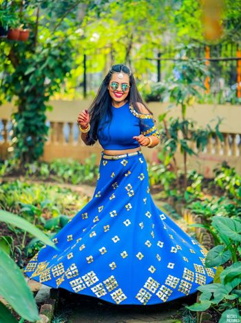 Happy bride in a blue lehenga twirling