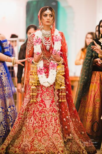 Red and gold embroidered bridal lehengas