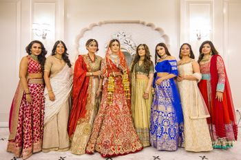 Photo of Bride with loads of bridesmaids in colourful outfits
