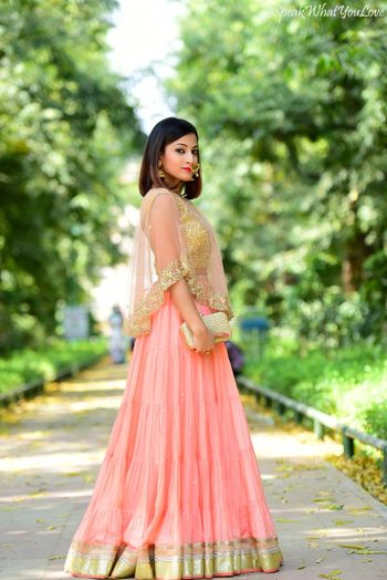 Photo of Peach and Gold Lehenga with Gold Clutch