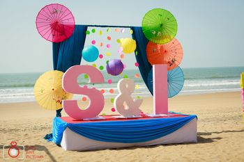 Giant monograms in beach wedding decor