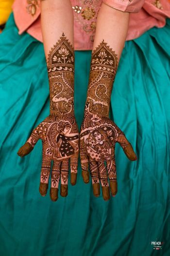 Photo of Bride and groom portrait half and half mehendi