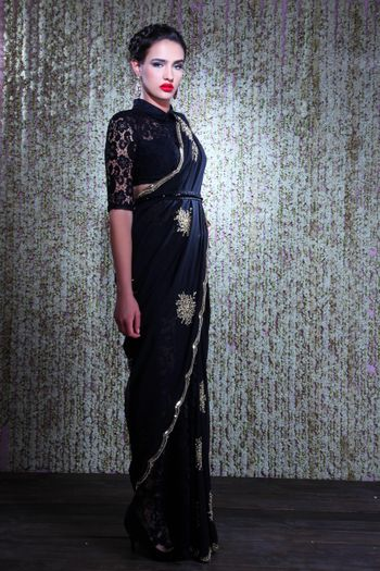 Black saree with net blouse and silver motifs