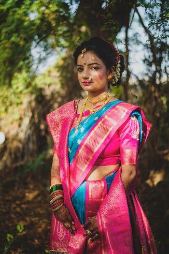 Unique combination of blue and pink nauvari saree