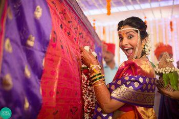 Super excited bridal portrait in a maharashtrian wedding