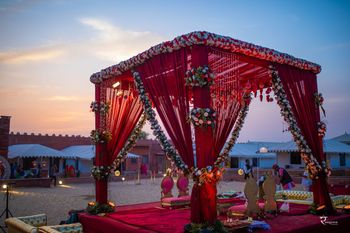 Maroon mandap with floral strings