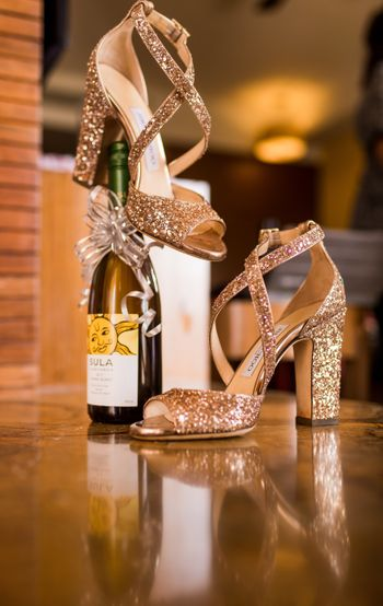 Photo of Gold shimmery bridal jimmy choo shoes