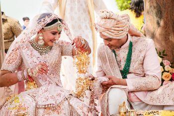 Photo of Pastel twinning bride and groom