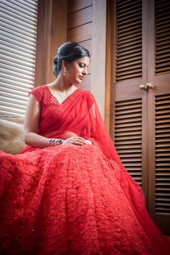 Photo of red modern bridal lehenga