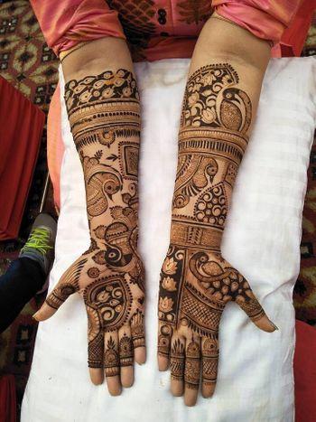 Beautiful lotus motif and peacock design bridal mehendi