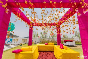 Mehendi seating decor idea in pink and yellow
