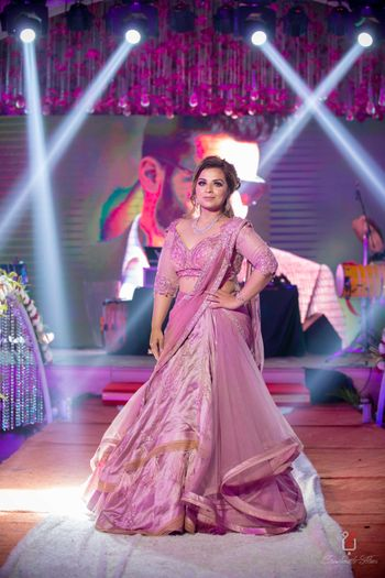 Sangeet lehenga in onion pink colour with draped silhouette