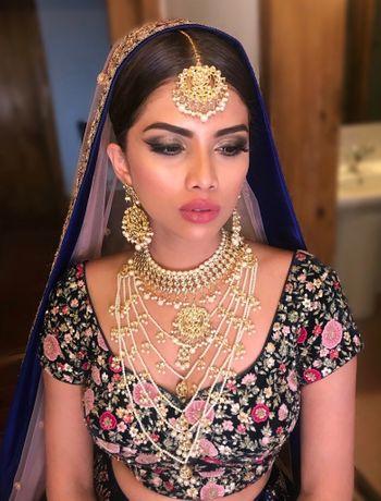 Pretty satlada necklace on a bride to be