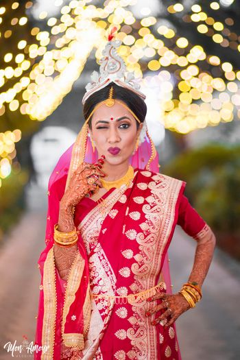 Pretty bengali bride in traditional makeup and red saree