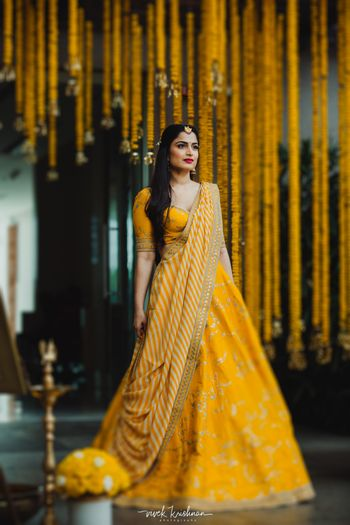Stunning yellow mehendi lehenga with a patterned dupatta
