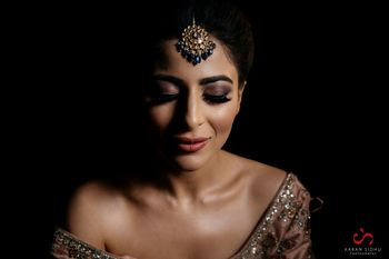 Photo of Bride with bold brows and dark brown smokey eyes