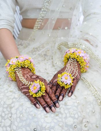 Photo of Dry floral yellow mehendi haathphool