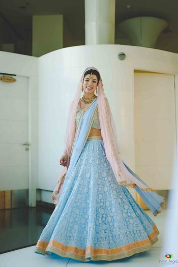 Light bridal lehenga with light blue and light pink