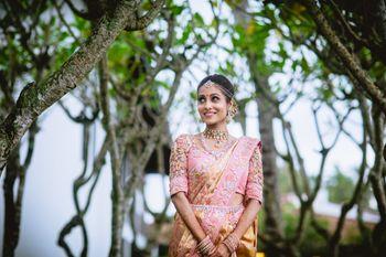 Offbeat South Indian bride in light pink kanjivaram