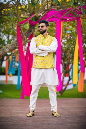 Quirky mehendi groomwear with yellow jacket over kurta