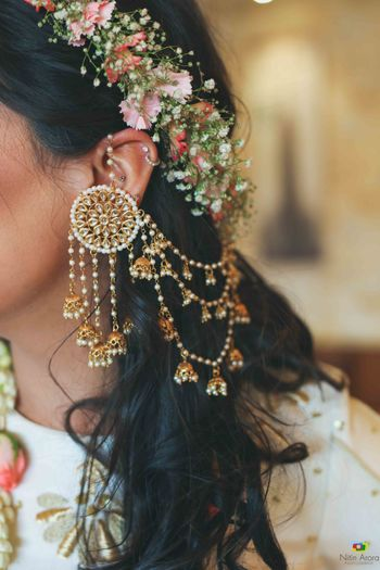 Pretty floral tiara on head with gold jhumkis