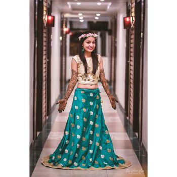 Bride in turquoise blue mehendi outfit