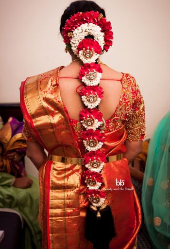 Floral jada with hair ornaments and flowers on South Indian bride