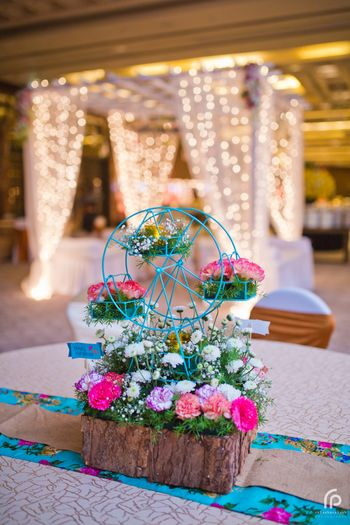 Photo of Tiny Ferris Wheel Floral Arrangement for Centrepiece