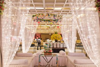 Photo of Sheer Curtains with Fairy Lights in Wedding Decor