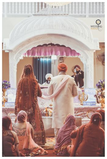 A sikh bride and groom during their anand karaj.