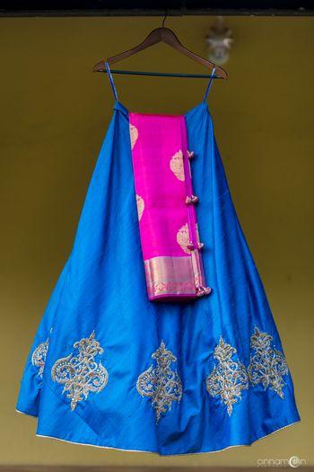 Bright blue lehenga with pink dupatta