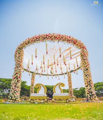 Circular floral mandap decor with strings